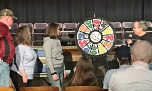 prize wheel game being played by attendees