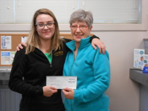 employee presenting check to a member