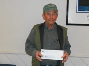 Man showing his winning check