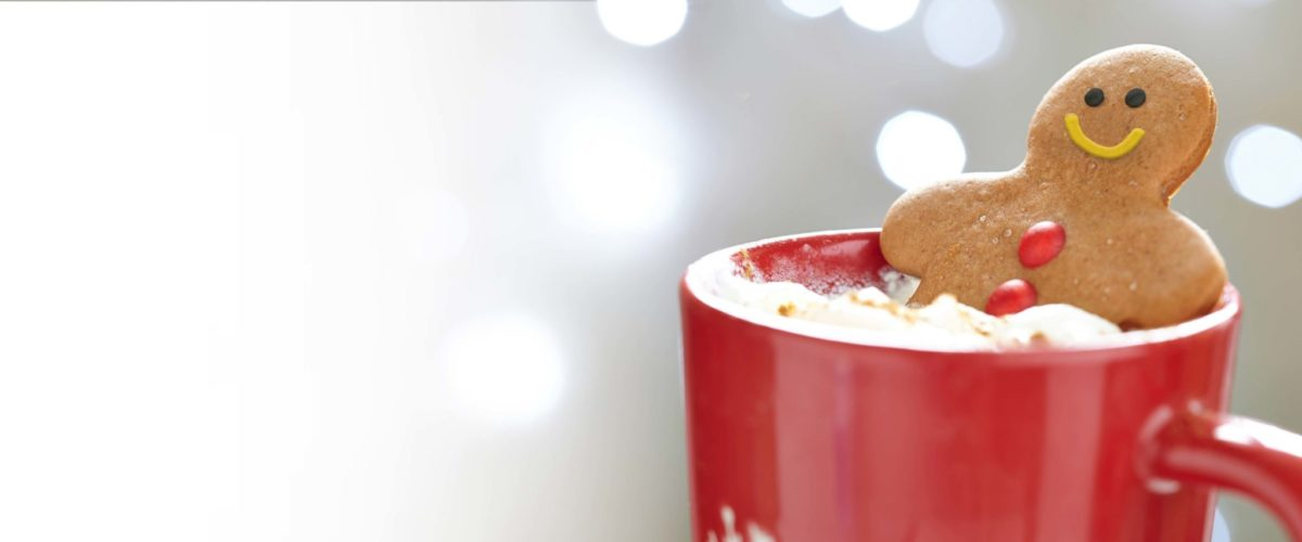 Gingerbread man relaxing in a mug of cocoa