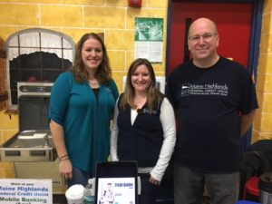 Three employees posing at vendor fair